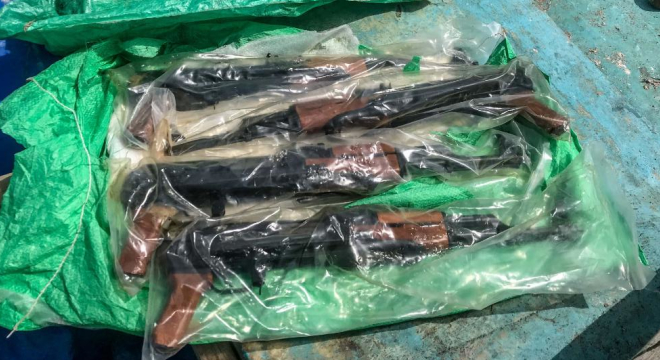 The guns, some 1,000 AK-pattern rifles, were discovered under deck clutter (Photos: U.S. Navy)