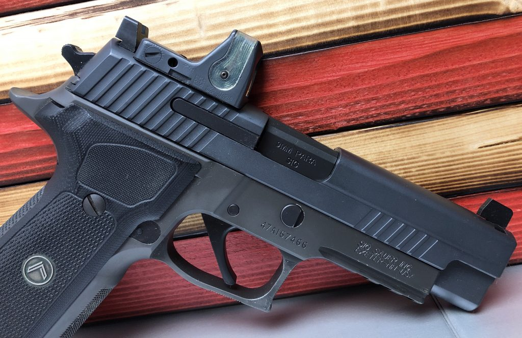 Sig p226 Legion with trijicon RMR and co-witness sights.
