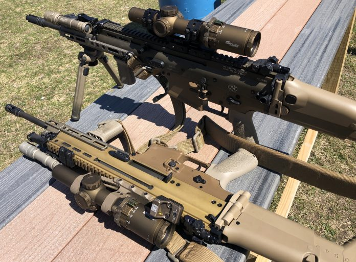 SCAR rifles heavily kitted with optic and rail upgrades