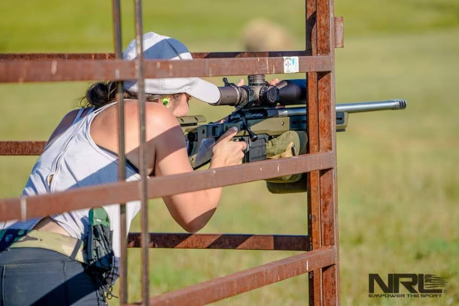 the author stephanie martz using a g-code 9mm mag pouch to retain the kestrel during a long range shooting match